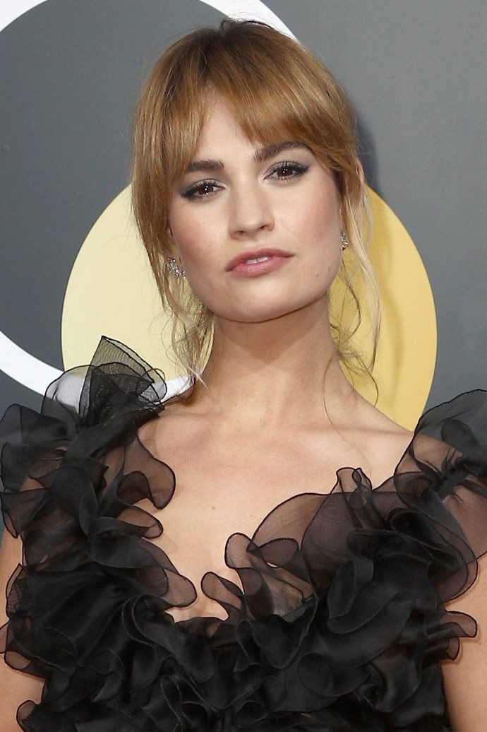**Lily James** <br><br> So frenchy, so chic Lily! The actress opted for an relaxed updo, letting a few of her strawberry blonde tresses loose. And of course, no french-inspired beauty look would be complete without a winged eye.