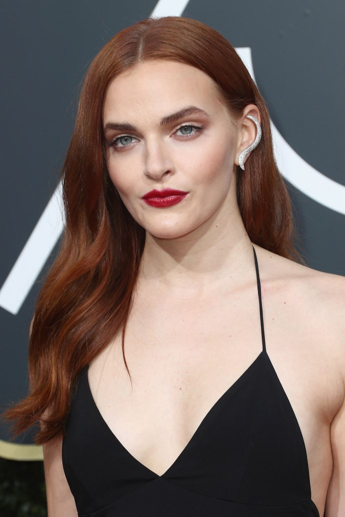 **Madeline Brewer** <br><br> Madeline Brewer is giving us *serious* Jessica Rabbit vibes with a side-parted, bright red 'do and a red lip.