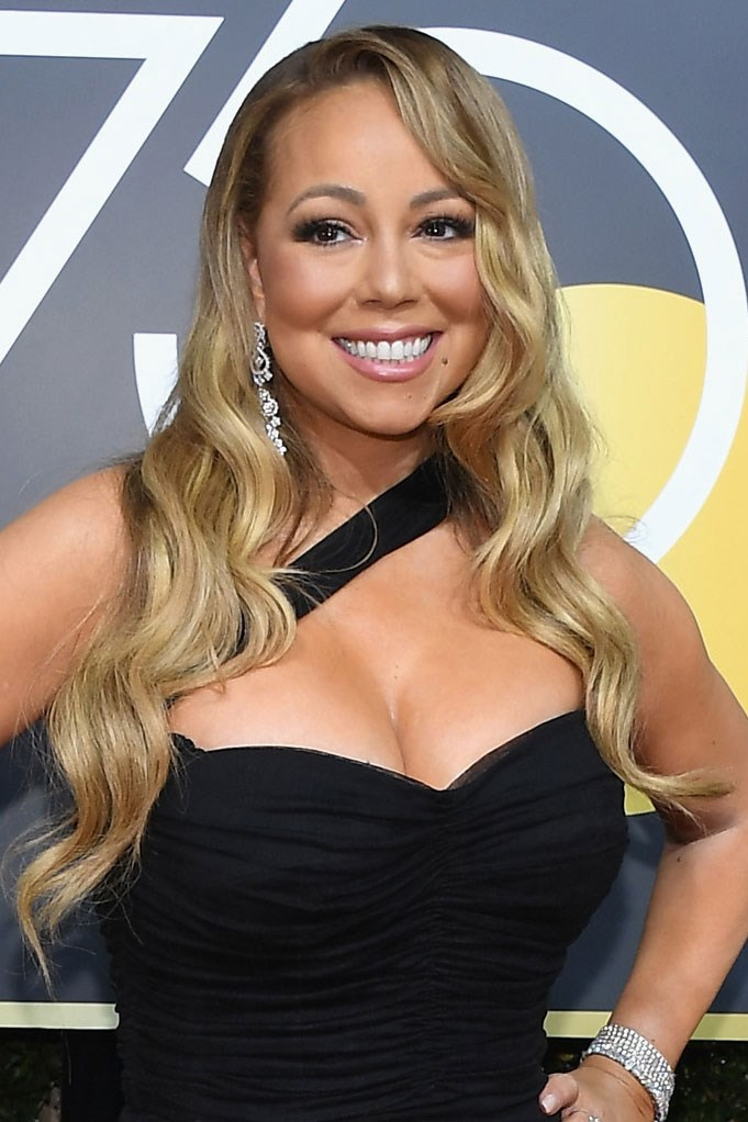 **Mariah Carey** <br><br> All hail Mariah, queen of extra! She opted for her signature long wavy 'do, super-long lashes and a glossy pink lip.