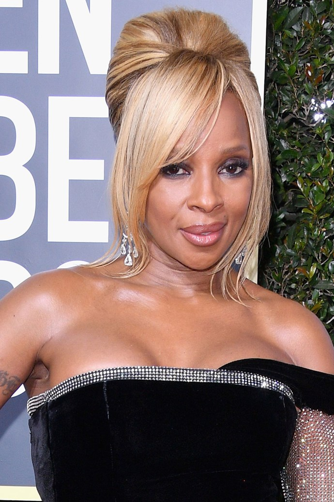 **Mary J Blige** <br><br> The rapper rocks a retro updo and cool-toned smokey eye to this year's red carpet.