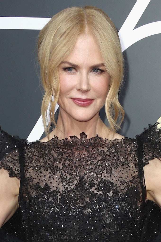 **Nicole Kidman** <br><br> Our Aussie Queen does relaxed chic like no other with a loose updo paired with subtle black liner and rose-tinted lips.