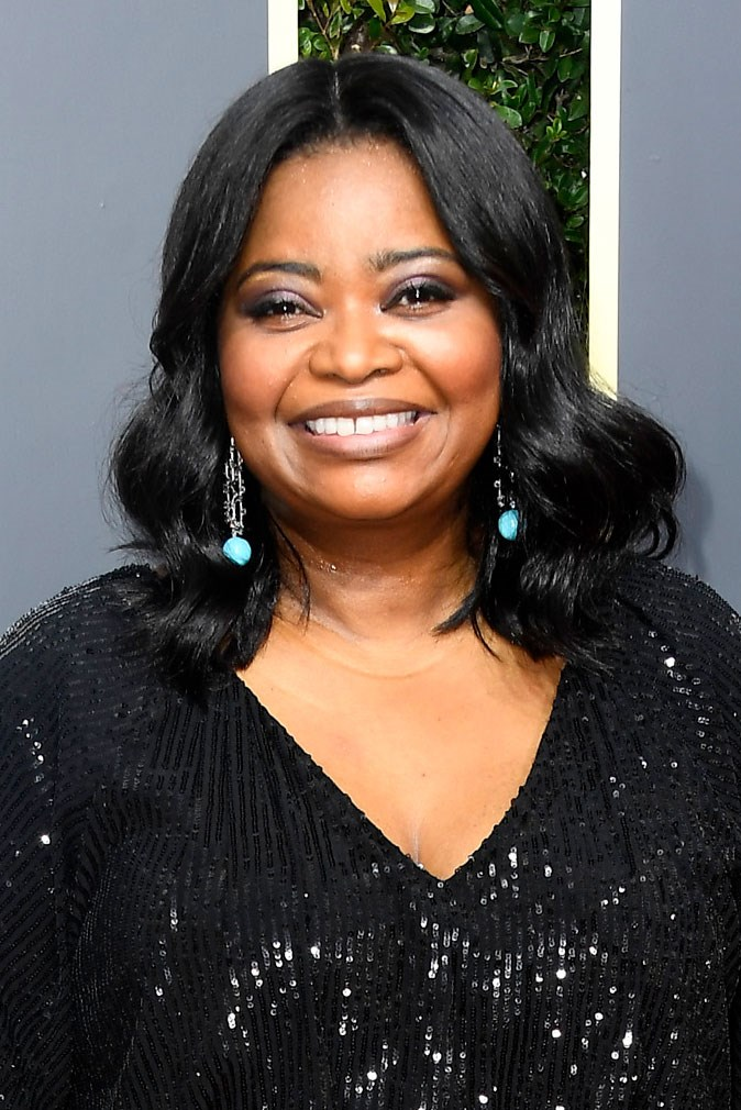 **Octavia Spencer** <br><br> The actress keeps her beauty look simple with soft curls and a pop of purple eyeshadow.