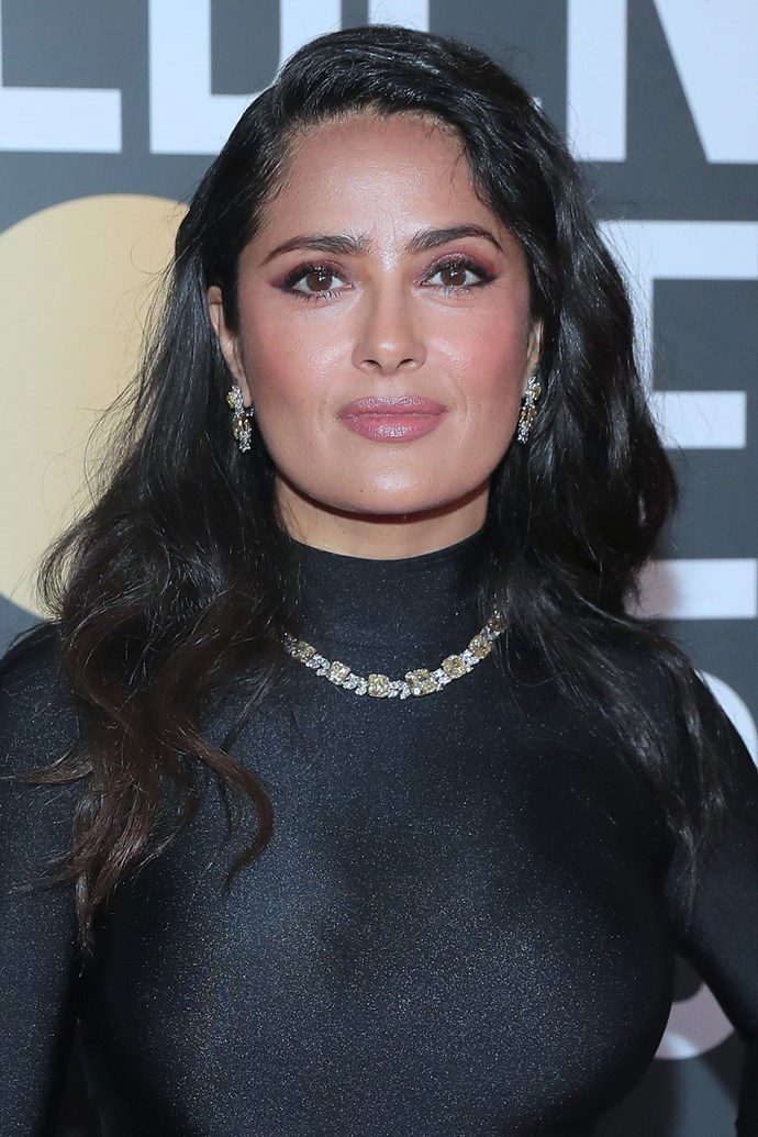 **Salma Hayek** <br><br> Salma opts for super warm tones and a deep-parted blow wave on this year's red carpet.