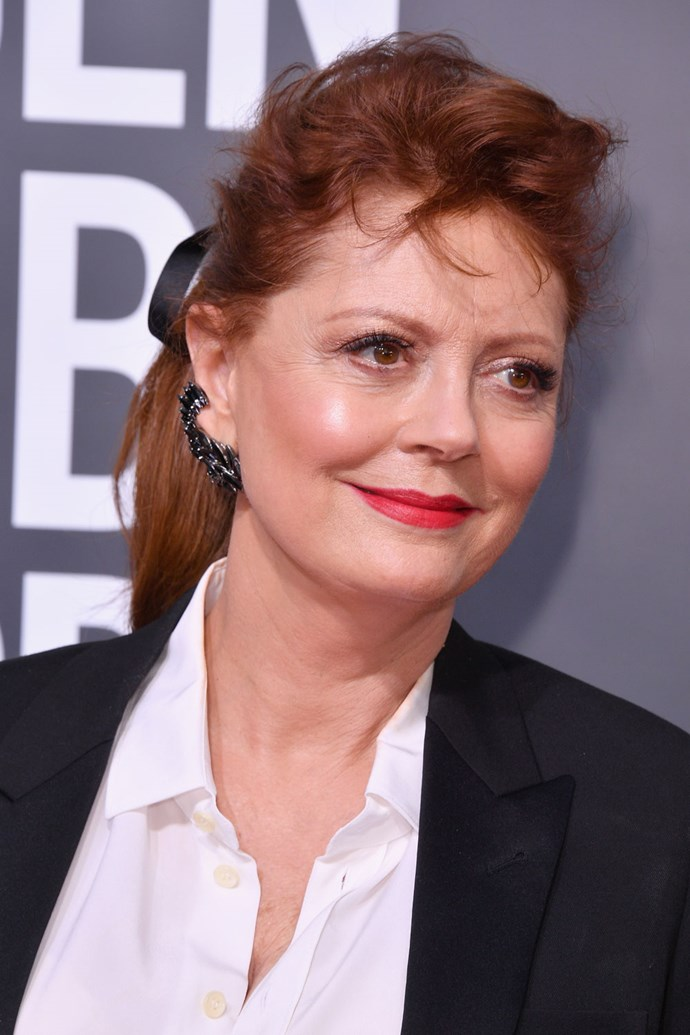 **Susan Sarandon** <br><br> Susan Sarandon gives us cool school girl with a simple pulled back pony complete with dainty black ribbon.