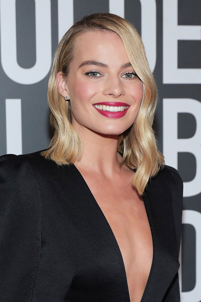 **Margot Robbie** <br><br> The *I, Tonya* actress also opted for a bright pink lip, pairing it with her signature deep-parted lob.