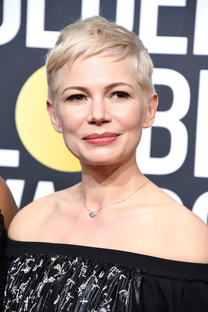 **Michelle Williams** <br><br> Never has someone made us want to chop all our hair off into a peroxide pixie 'do than Michelle Williams. The actress completes her look like a pink lip tint and heavy winged eye.