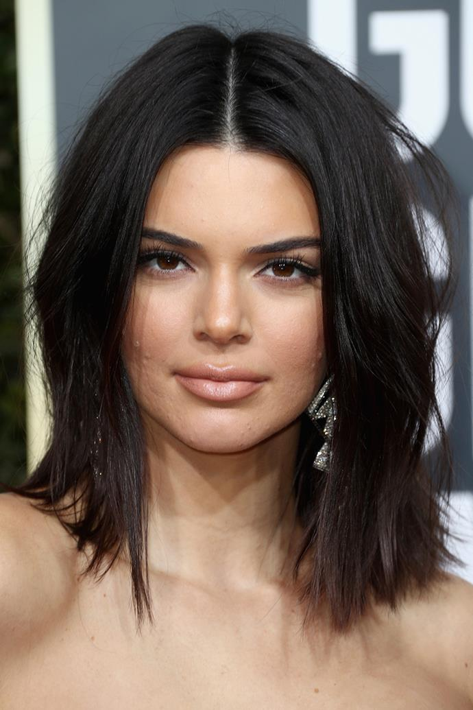 **Kendall Jenner**'s lived-in locks will give you instant I-woke-up-like-this sexiness. Get the effortless style by prepping damp hair with a volume mousse, then blow-drying smooth. Once dry, use a hair curling iron (don't forget to prime hair with a heat protector) to give hair a bend at the mid-lengths. Flick your head upside down and spritz hair with a finishing spray. Move fingers through strands to achieve Kenny's mussed-up texture, before finishing with a light-set hairspray. First impression = done right.