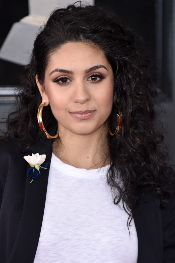 **Alessia Cara** <br><br> We're loving Alessia Cara's toned-down beauty look here, complete with half-up half-down curly 'do and a soft smoky eye.