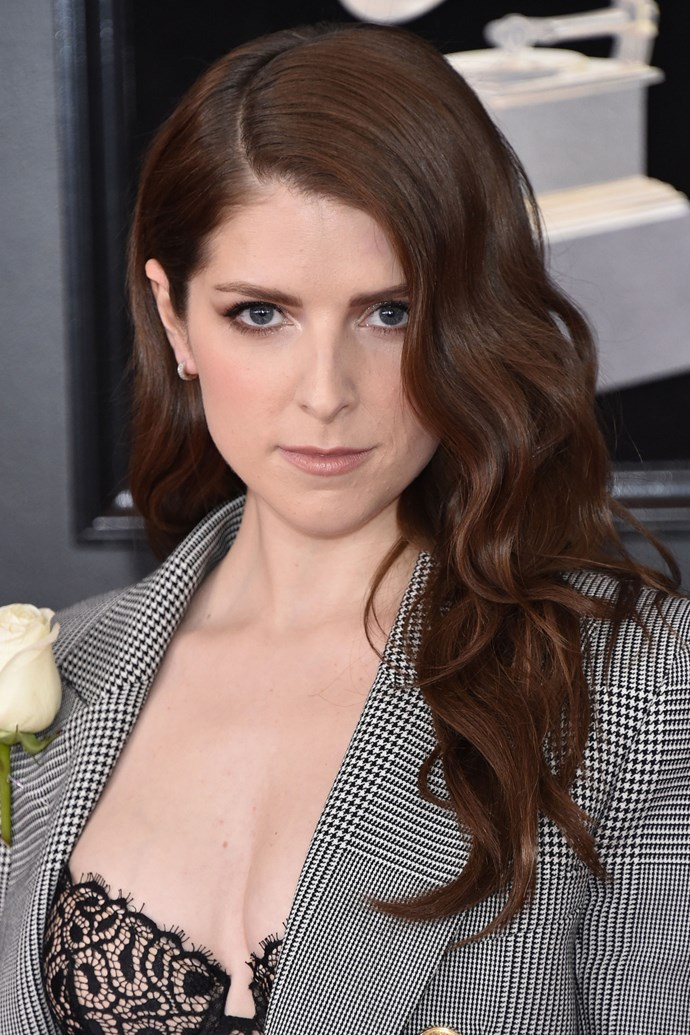 **Anna Kendrick** <br><br> The *Pitch Perfect* actress kept her look simple, going with side-parted waves and a light smoky eye.
