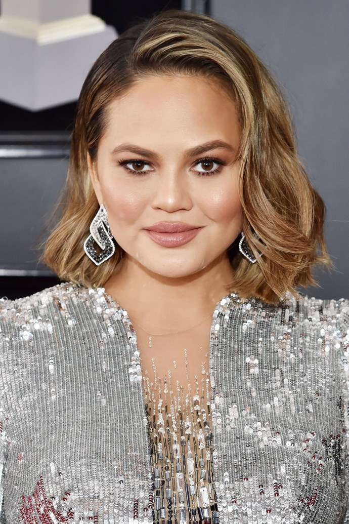 **Chrissy Teigen** <br><br> We think that Ms. Teigen may have just debuted a fresh chop on this year's Grammy red carpet! She paired her pregnant glow with a brown smoky eye and nude lip.