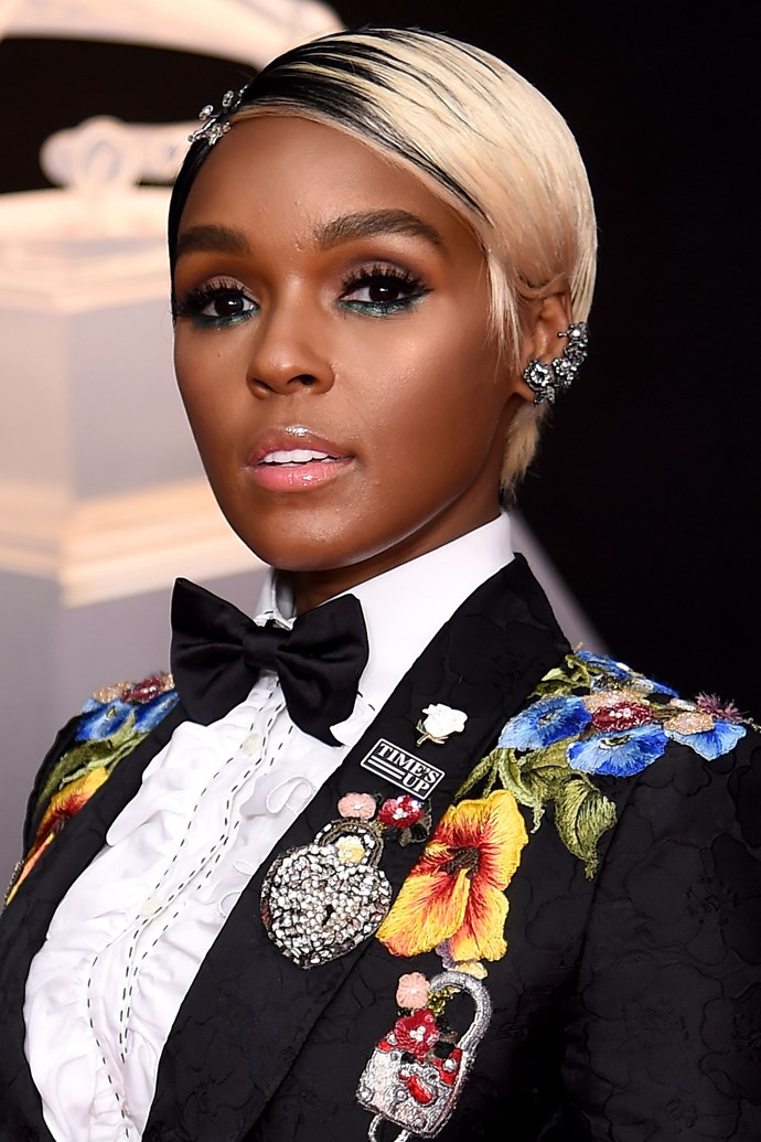 **Janelle Monae** <br><br> Janelle also mastered glowy skin, and paired it with electric green underliner and a two-toned pixie.