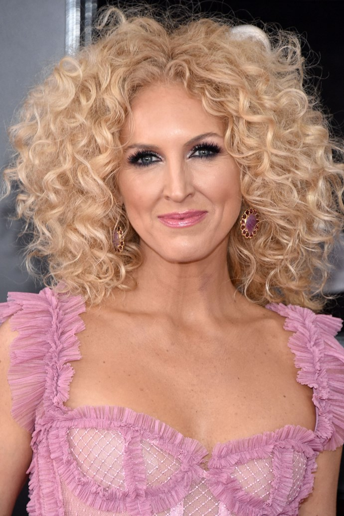 **Kimberly Schlapman** <br><br> And band mate Kimberly stuck to what she knows best when it comes to her red carpet look, sporting her signature blonge bob and matching silver smoky eye.