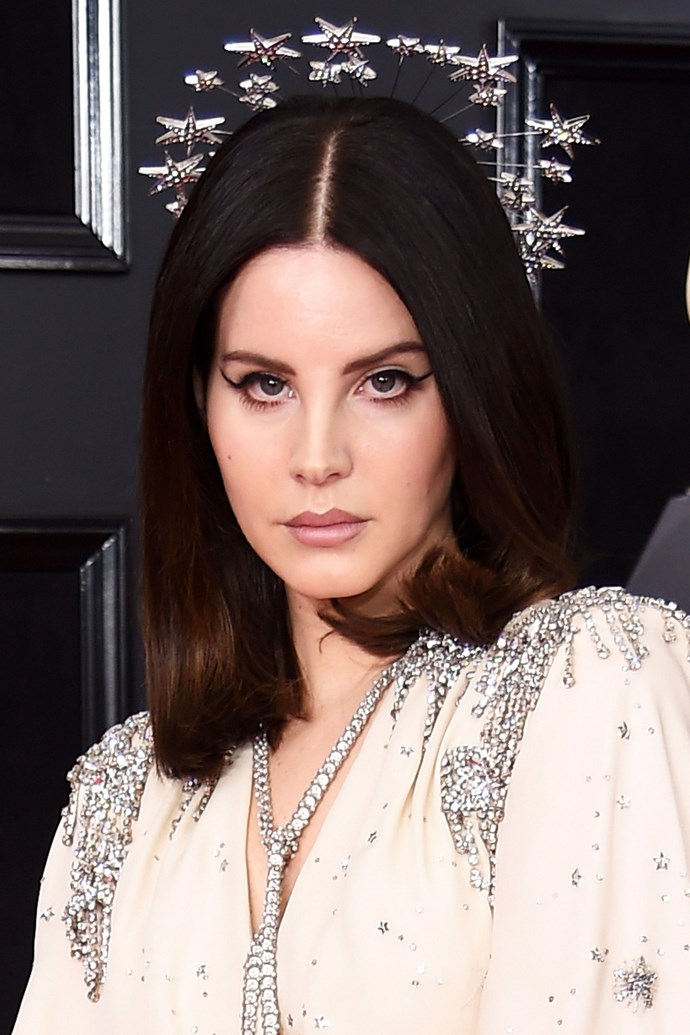 **Lana Del Rey** <br><br> We're living for Lana's starry head piece, sharp cat-eye and chiseled lips.