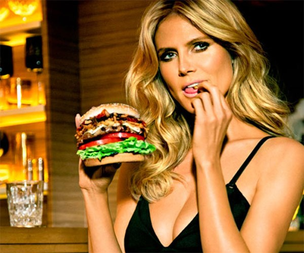 Oh look, it's Heidi Klum eating a burger and - you guessed it - licking her fingers.