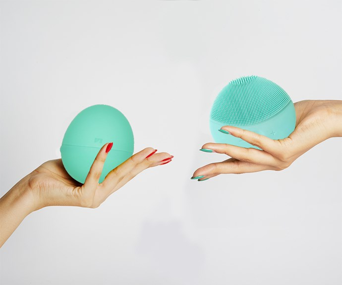 Hands holding vibrators.