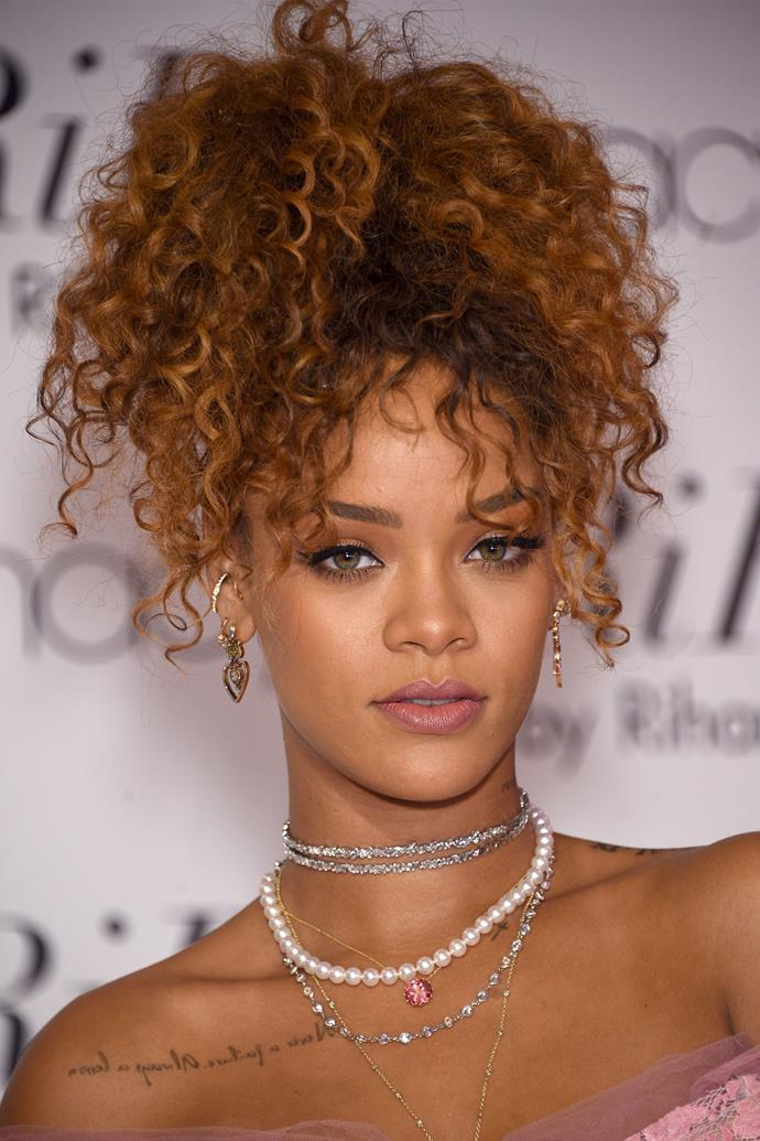A few months later, Rihanna was still loving her warm-toned hair. She pulled her natural curls into a hi-pony to channel Sideshow Bob-chic. And we'll never get enough of her often repped flawless winged eye.