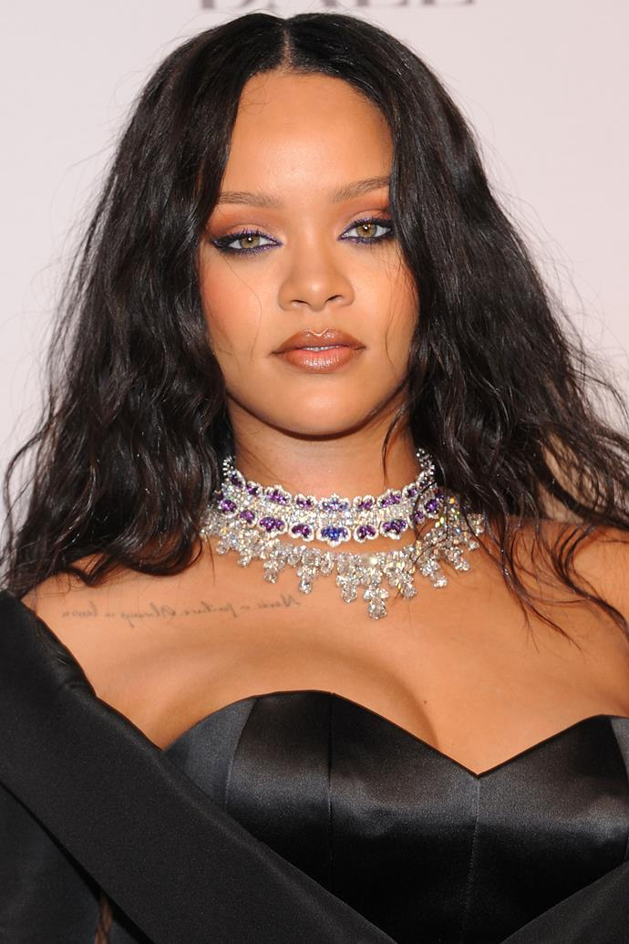 Is witch chic a thing? Because if it is, Rihanna 100% pulled it off with long wavy locks and purple lined eyes.