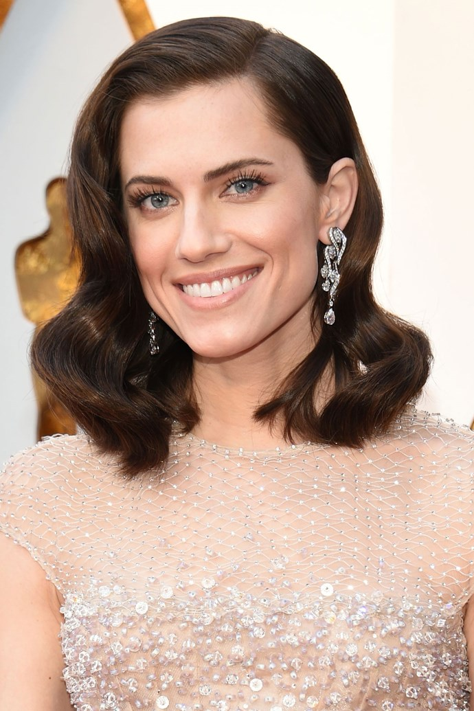 **Allison Williams** <br><br> The *Get Out* actress has turned out glam look after glam look this red carpet season, and her Oscars hair and makeup is no different. Give us big barreled curls and a glittery platinum lid any day!