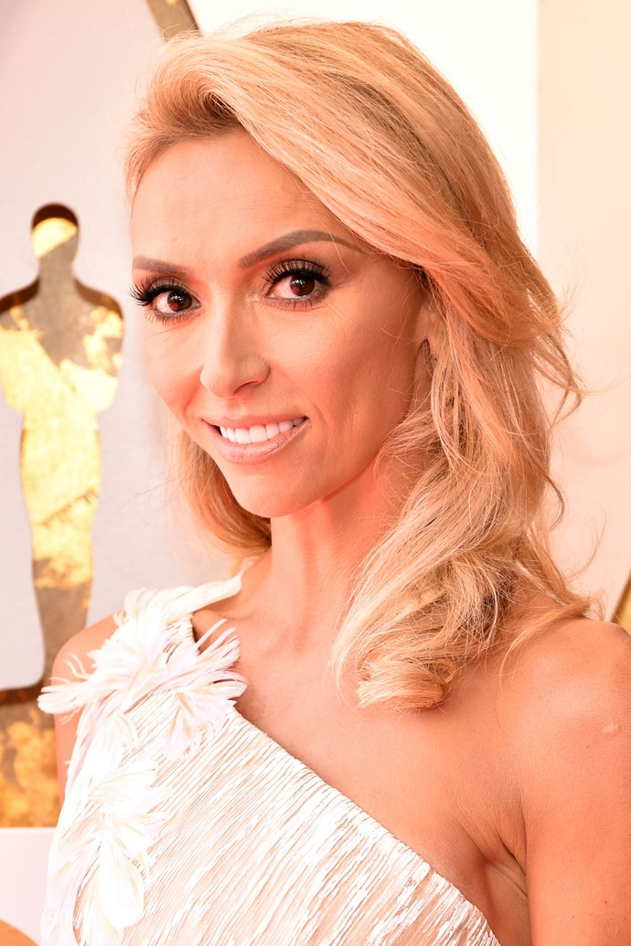 **Giuliana Rancic** <br><br> The E! veteran went with quite the pulled back hair and makeup look for this year's red carpet, having a bold brow and matte black lined lid as her stand-out features.