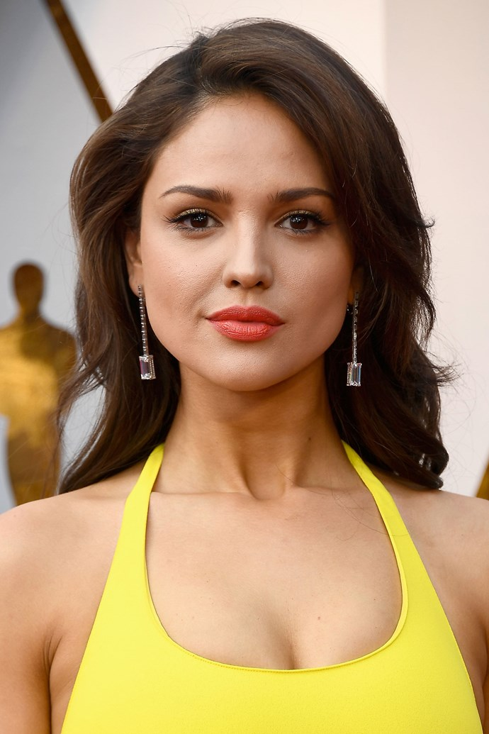 **Eiza Gonzales** <br><br> The Mexican actress and singer wore a pop of orange on her lips to match her equally popping bright yellow gown.