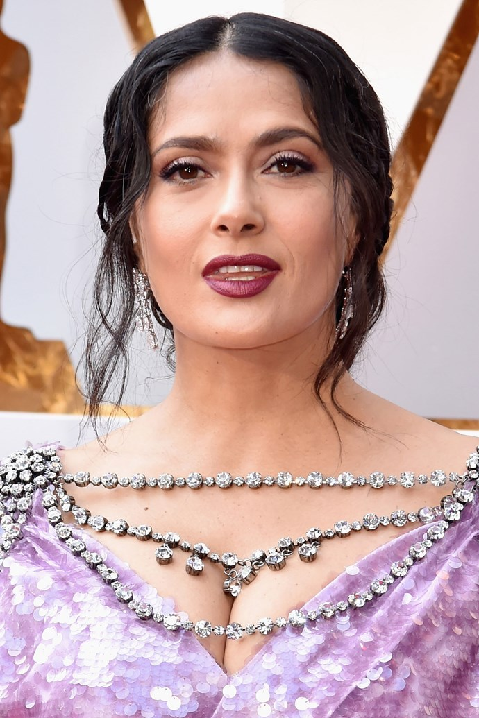 Salma Hayek Pinault <br><br> The actress sported a relaxed updo, letting a few tendrils of her hair fall by her face. But she amped up the glam with a dramatic purple lid and lip combo.