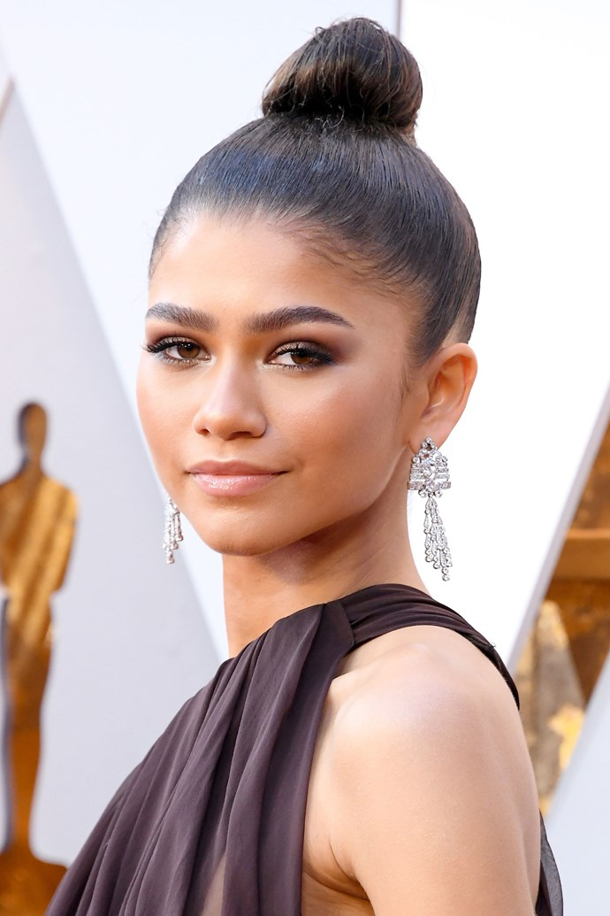 **Zendaya** <br><br> The *Greatest Showman* actress stepped out in a sleek ballerina bun, full brows and a mulberry smoky lid.