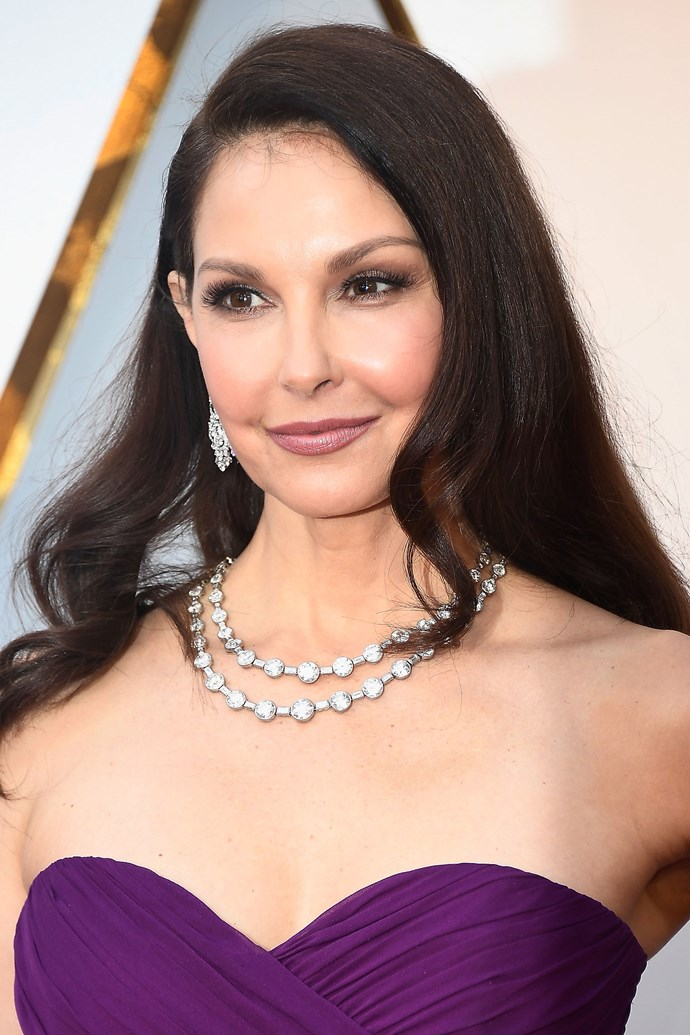 **Ashley Judd** <br><br> The actress rocked lashes for days and a purple toned eye and lip combo to match her outfit.