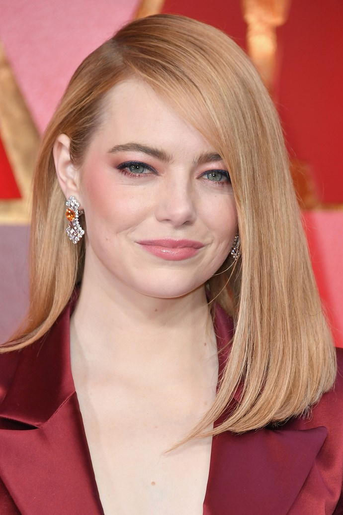 **Emma Stone** <br><br> File Emma Stone under 'stunning red carpet hair and makeup'. We cannot get enough of her peachy lid and cheek combo, glossy pink lip and deep-parted, side sweeping lob.