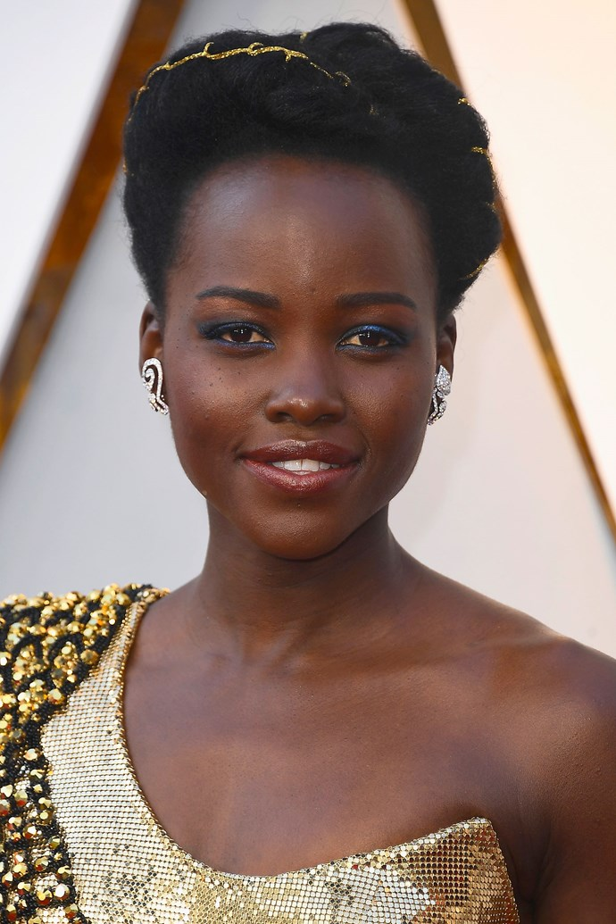 **Lupita Nyong'o** <br><br> If we can summarise Lupita Nyong'o beauty look in one work, it would be STUN-NING! The gold threat woven into her braided up do, the electric blue eyeshadow, the gleaming skin... LOVE!