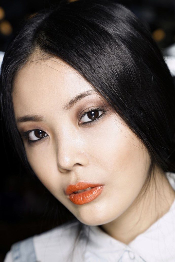 **Griege eyes and an orange lip** <br><br> If the thought of a barely-there makeup look has you yawning, go for something a little bolder. This glossy smoked-out eye and orange lip, is the best example of sophistication meets cool-girl.
