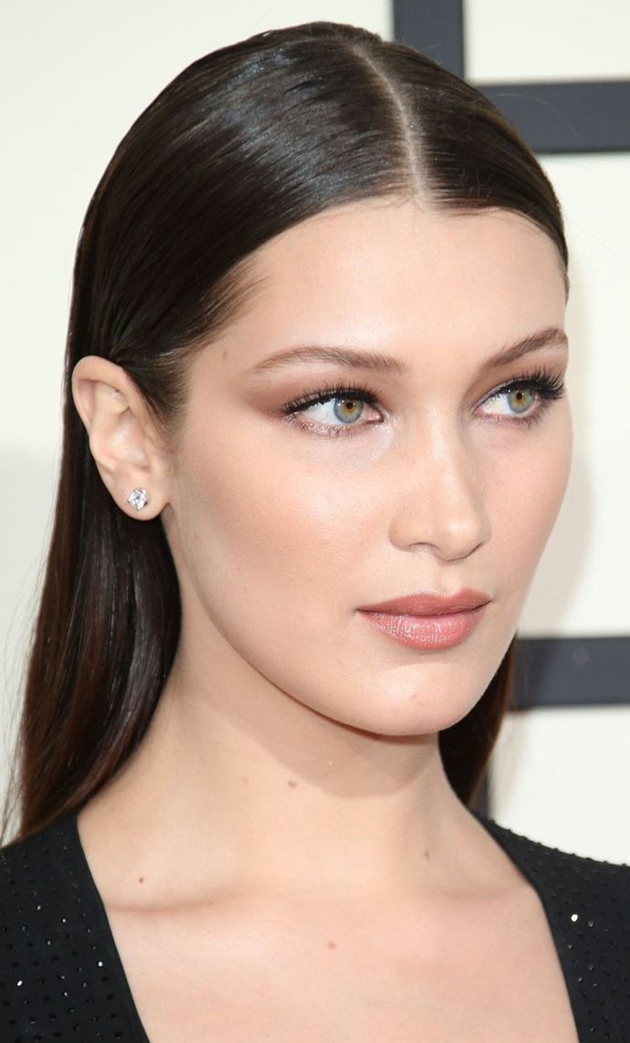 **Matte meets shimmer eyes** <br><br> Bella Hadid's makeup is perfect for the big day. A touch of shimmer on the eyes teamed with a soft, matte, brown shadow is sultry but sophisticated. Team with a dewy nude lip and subtle contouring...?