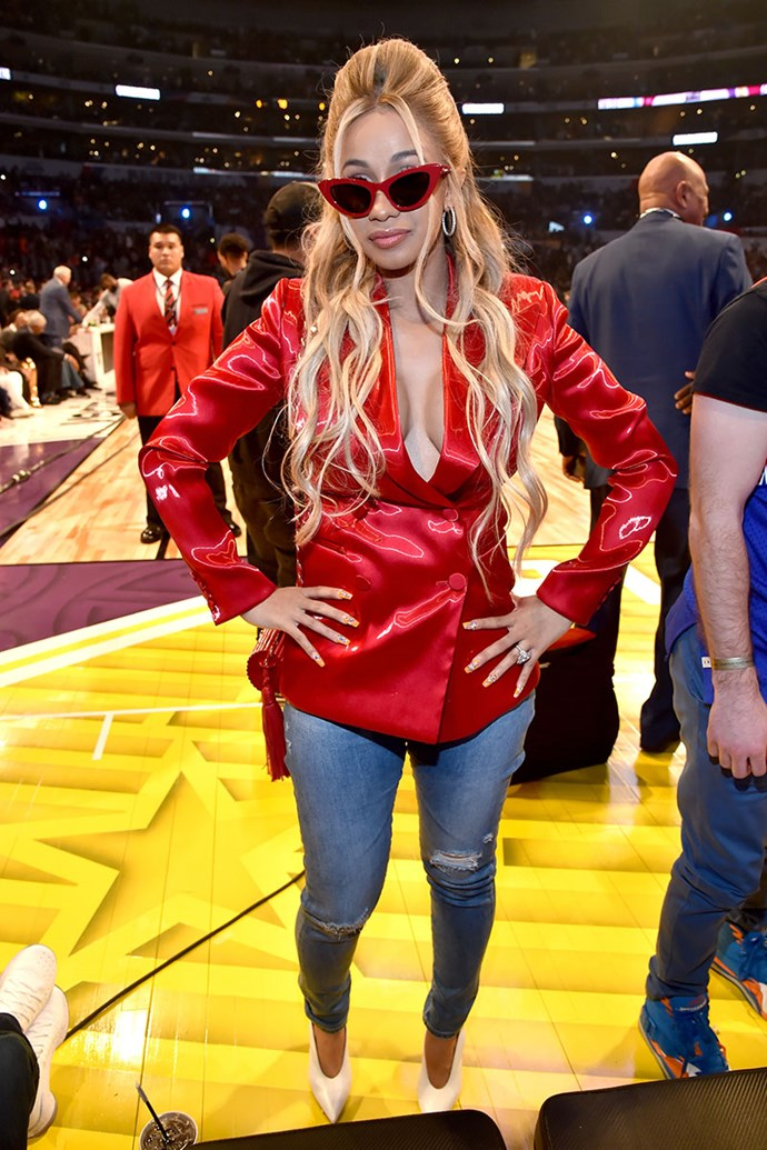The only thing better than Cardi's insanely sexy cherry red blazer, is when it's paired with matching cat-eye specs.
