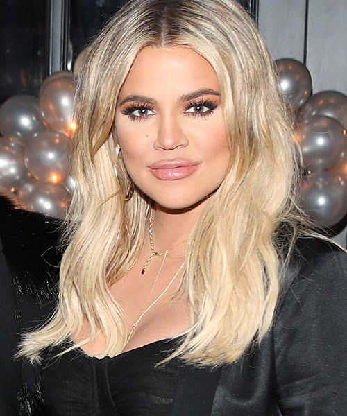 At her most recent appearance, Khloé stepped out with beachy blonde waves for Tristan's birthday party.