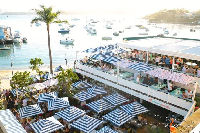 **Watson's Bay Hotel**  Covered with blue and white umbrellas, Watson's Bay Hotel has the ultimate summer vibe. With a beautiful view and equally beautiful decor, you can't really lose.