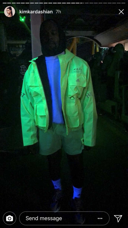 Kanye West modelling a fluro jacket at Travis Scott's birthday party. Kiiiiinda looks like a sad ride attendant.