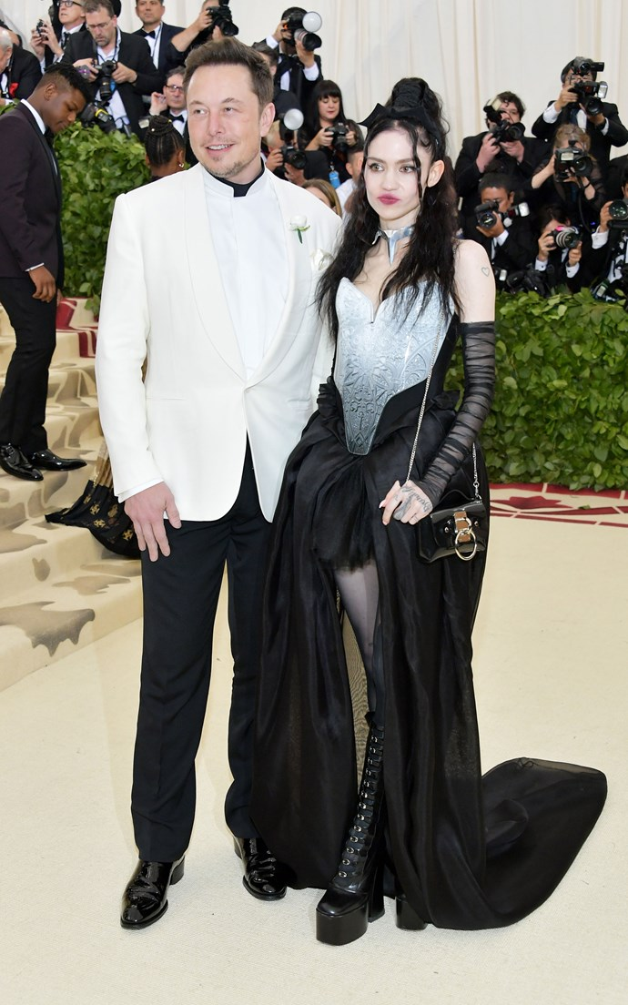 """**ELON MUSK AND GRIMES** <br><br> And the award for most random couple to announce their relationship at this year's Met Gala goes to…. Elon Musk and Grimes. <br><br> Last we heard, Elon was [in an on-again-off-again relationship](https://www.cosmopolitan.com.au/celebrity/amber-heard-and-elon-musk-are-officially-dating-21853