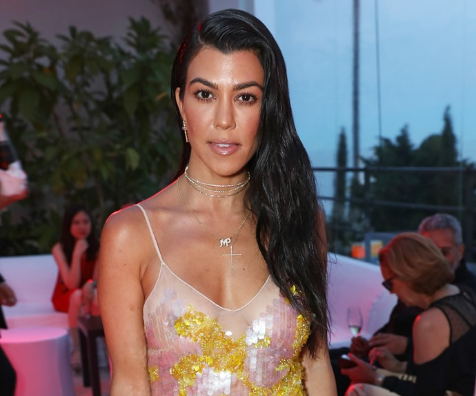 Kourtney Kardashian just posted a bikini pic and her 8-year-old son Mason was the photographer