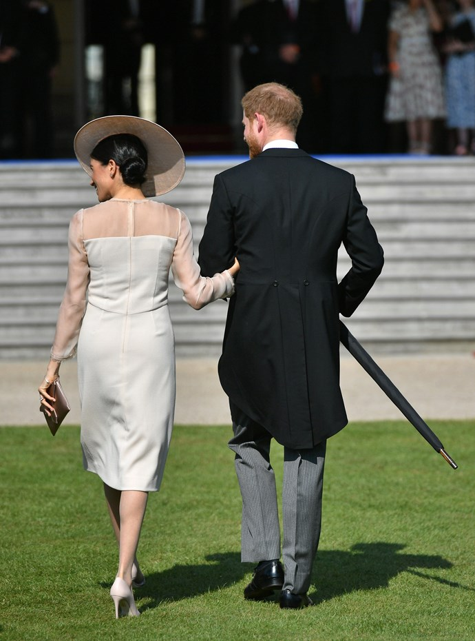Harry was a gentleman escorting his new wife across the lawn in her stiletto heels.