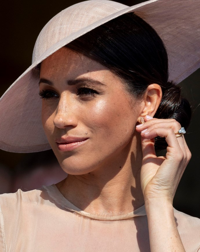Meghan's makeup was glowy and she had a her hair swept up in a tidy bun.