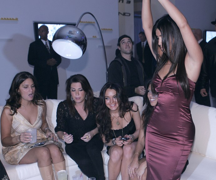 That time Kim sat at a club table with LiLo in 2006, and was the only one dancing. 2006 was *truly* a different era.
