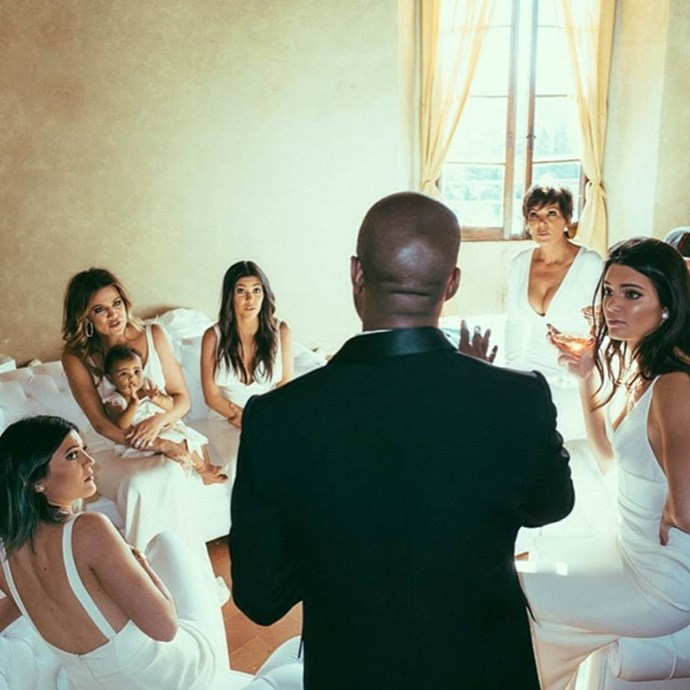 Khloe posted this snap pre-wedding showing the Kardashian chicks seemingly getting a pre-wedding briefing from the groom. (Side note: KRIS' BOOBS).