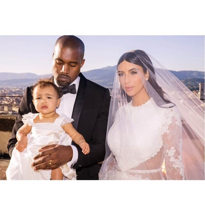 Kim once upon a time reminiscing about the big day, sharing this totally adorably family pic with then-baby North. We're not sure whose custom-made Givenchy dress is more beautiful.