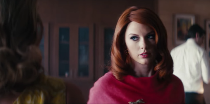 Taylor Swift with her red hair in Sugarland's *Babe* video.