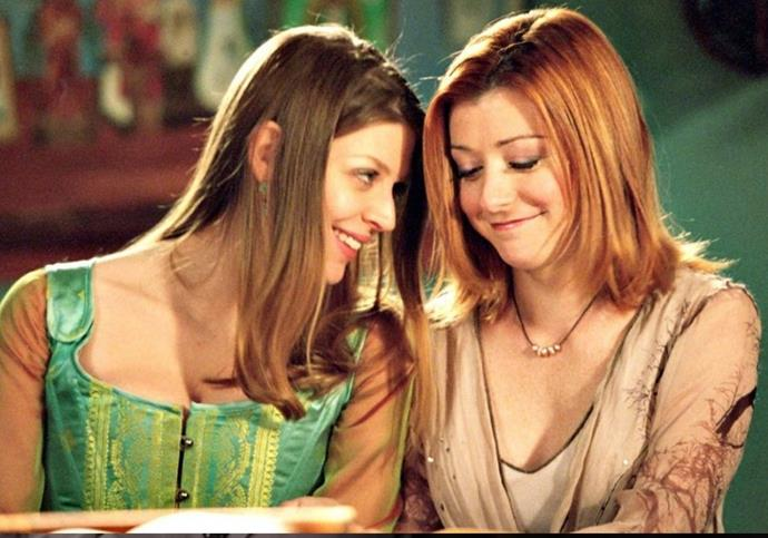 **Willow and Tara — *Buffy The Vampire Slayer*** <br><br> Willow and Tara's relationship put *Buffy* on the map, and we can totally see why. Their first meeting was magic as hell with their telekenetic escape from ghouls, after which, things only get more intense. As is often the case in supernatural shows, one of the lovebirds dies, but they'll always live in our hearts.