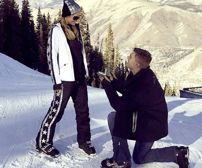 Paris Hilton and Chris Zylka <br><br> Actor Chris Zylka popped the question to Paris Hilton with a 20 carat ring (nothing less) on the ski slopes of Aspen.