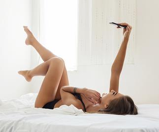 Woman taking sexy selfie.