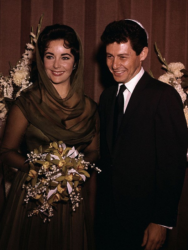 **Liz Taylor's Wedding to Eddie Fisher**  You can't talk about scandalous celebrity weddings without mentioning Elizabeth Taylor, the *queen* of scandalous celebrity weddings. One of her most scandalous was her 1959 wedding to Eddie Fisher, with whom she began an affair after the death of her previous husband Mike Todd. The problem? Fisher was still married to Debbie Reynolds. Then, in 1962, Taylor started having an affair with Richard Burton while still married to Fisher. Goals.