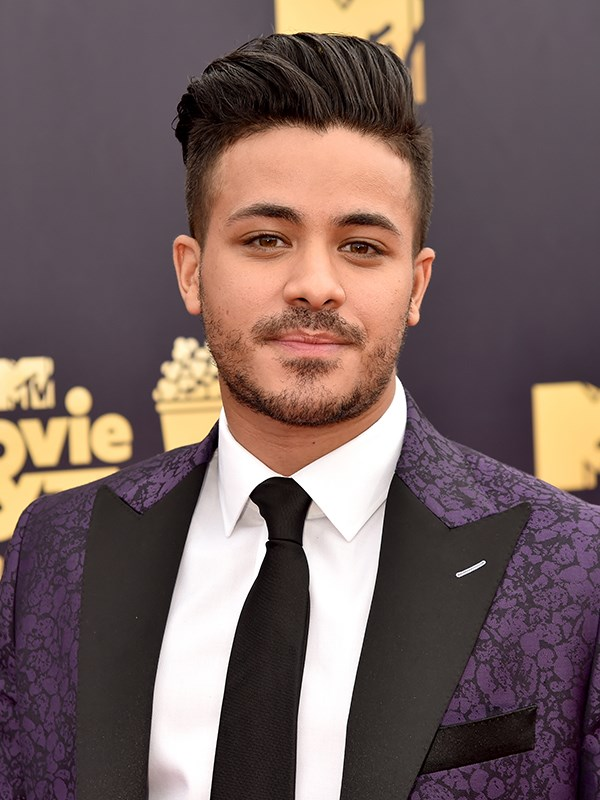 """**Christian Navarro** <br><br> Christian [recently revealed](https://www.popsugar.com/celebrity/Christian-Navarro-From-13-Reasons-Why-Single-43541928