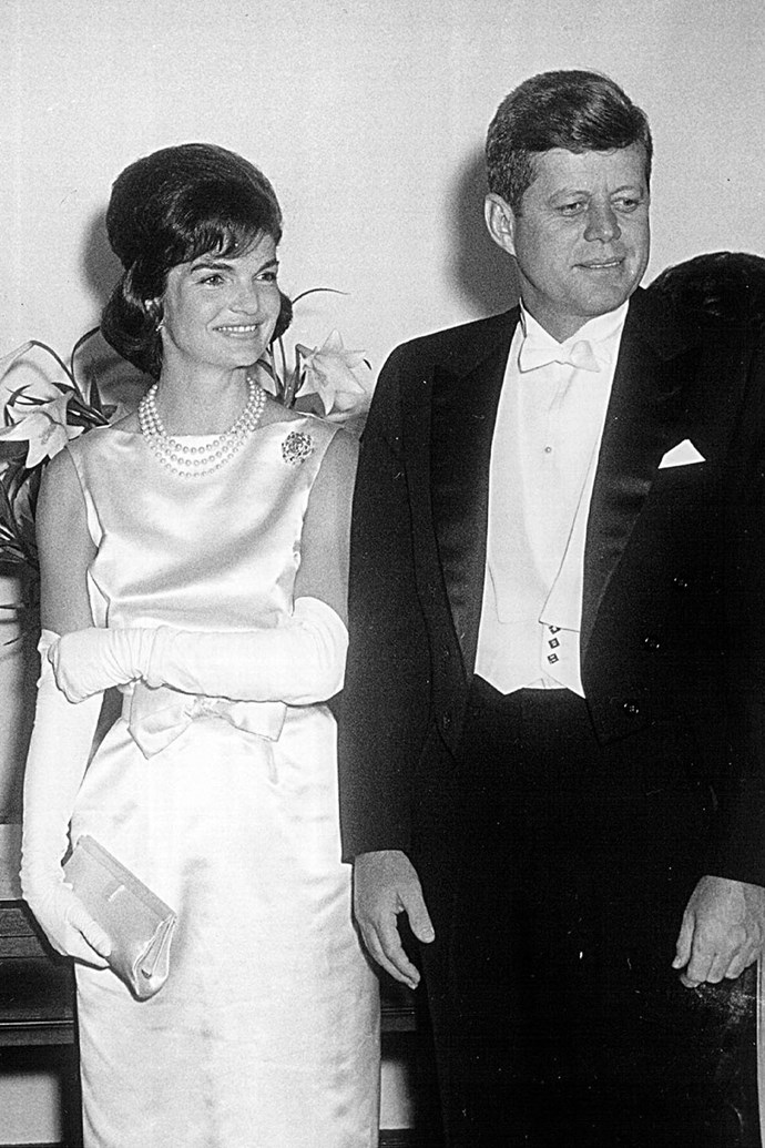 **1961: John and Jackie Kennedy** <br><br> On Jan. 20, 1961, John F. Kennedy and Jacqueline Kennedy became prom king and queen (you know, President and First Lady) of the United States. The pair were introduced by a mutual friend at a dinner party nearly a decade earlier and were married shortly after. The couple brought youth, style, and a sense of glamour to the White House — some scandal, too — and remained together until his assassination in November 1963.
