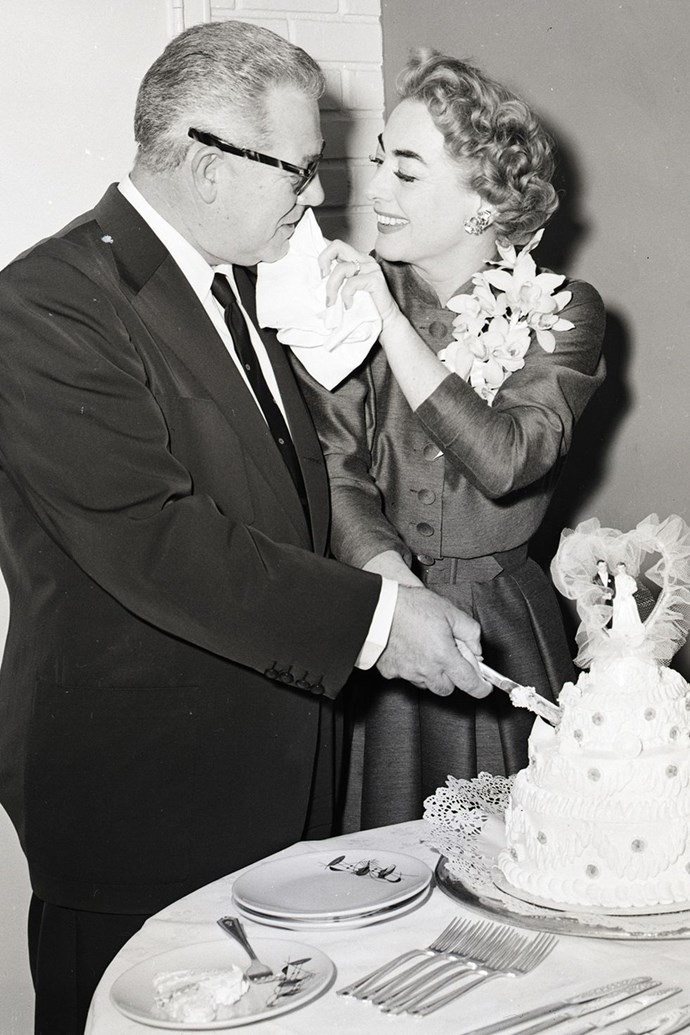 **1958: Joan Crawford and Alfred Steele** <br><br> Fourth time's the charm — actress Joan Crawford wed her fourth (and final!) husband Alfred Steele, the CEO of Pepsi-Cola Company, in a 1955 Vegas wedding, and in sunny black-and-white photos from 1958, the couple looked to be enjoying a happy, glitzy, California life together. Unfortunately, Steele passed away from a heart attack the following year. It's been reported that longtime rival Bette Davis had a Coke soda machine installed in her dressing room on the set of 1962's *What Ever Happened to Baby Jane*?, which Crawford also starred in, to spite her.